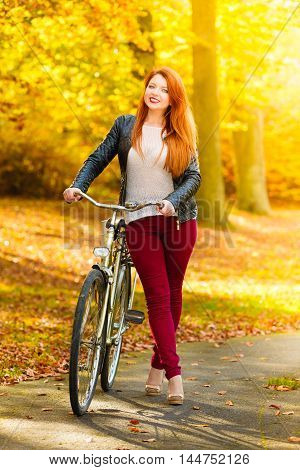 Beauty Girl Relaxing In Autumn Park With Bicycle, Outdoor
