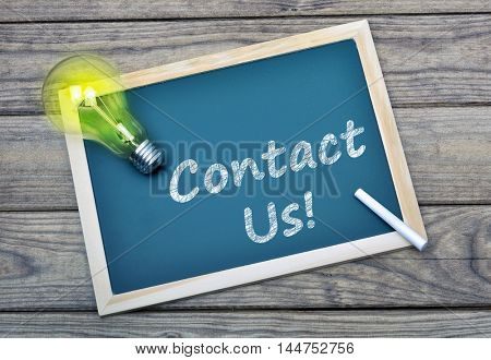 Contact Us text on school board and glowing light bulb