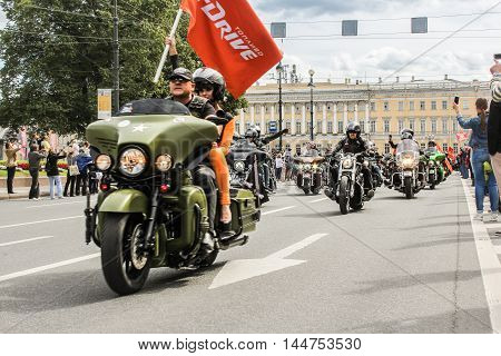 St. Petersburg, Russia - 13 August, The representative of the sponsor with a flag,13 August, 2016. The annual International Motor Festival Harley Davidson in St. Petersburg.