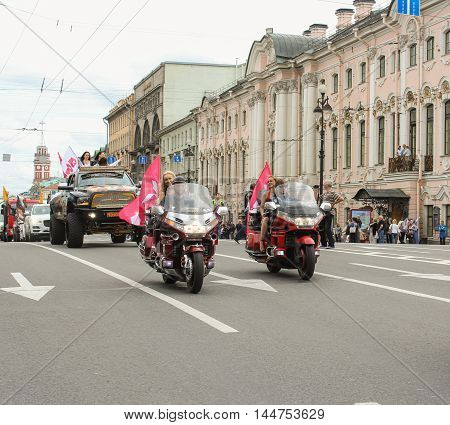St. Petersburg, Russia - 13 August, Motorcycles and large SUV on the Nevsky Prospekt.,13 August, 2016. The annual International Motor Festival Harley Davidson in St. Petersburg.