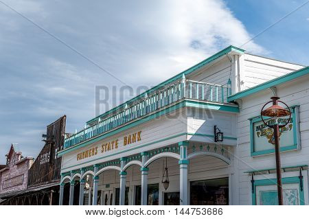 Winthrop Washington State USA - June 18 2006 : Farmers State Bank building of western style with balcony at the top in Winthrop Washington State USA