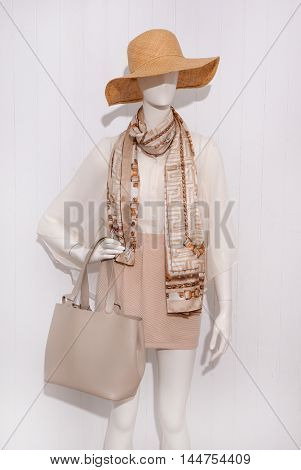 female clothing with hat,scarf ,bag on mannequin