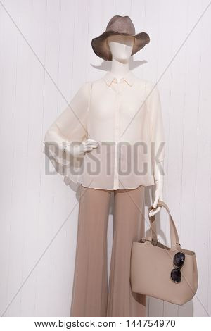 female clothing with hat,sunglasses ,bag on mannequin
