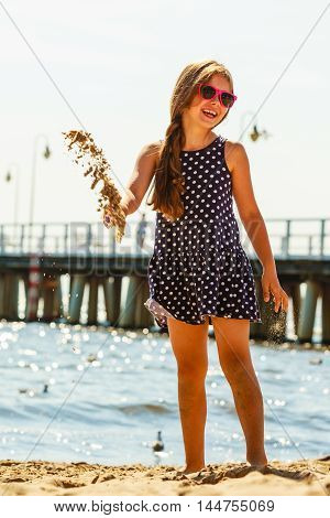 Girl Having Fun On Beach.