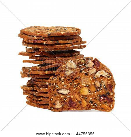 Autumn Themed Baked Crisps With Cranberries, Nuts And Seeds Stacked On A White Background