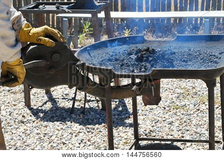 Old fashioned forging tray used by farriers to heat horseshoes.