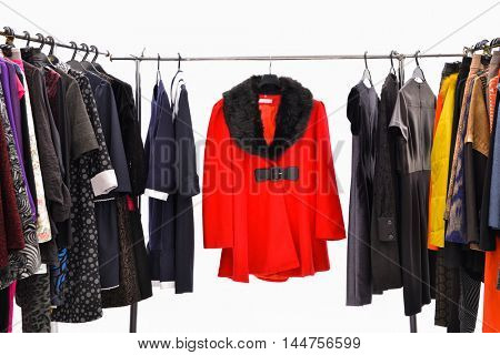 female autumn/winter clothing on hangers