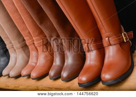 women's boots on the shelves in the store