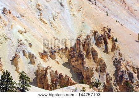 Rugged canyon walls and sandstone monoliths form this part of the view of the