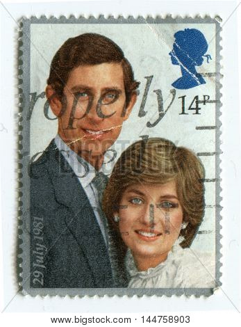 UNITED KINGDOM - CIRCA 1981: A stamp printed in United Kingdom shows portraits of Prince Charles and Lady Diana circa 1981