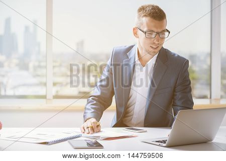 Smiling Businessman Working On Project