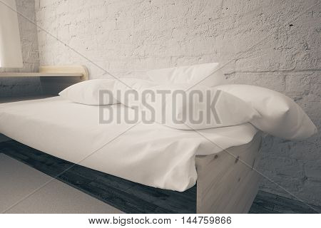 Closeup of bed with white pillows in interior with light brick wall and wooden floor. 3D Rendering