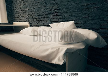 Closeup of bed with white pillows in interior with black brick wall and wooden floor. 3D Rendering