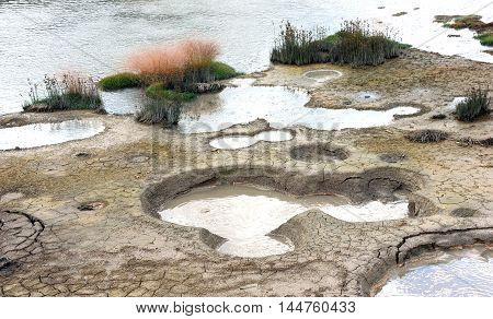 Mud holes holding water from the hot springs beneath the surface are part of the