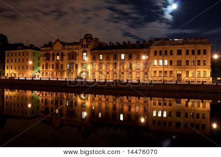An old Russian building in St. Petersburg with a reflection in the Fontanka river
