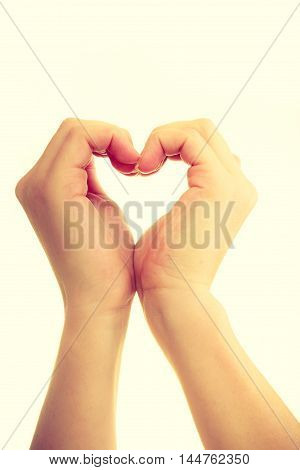 Love and help. Smoothy female hands in shape of heart sign symbol of charity and fondness.