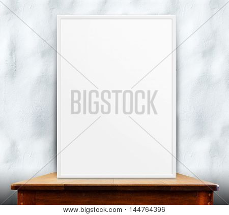 Empty White Frame On Wooden Table At Ripple Concrete Wall In Background,mock Up For Adding Your Desi