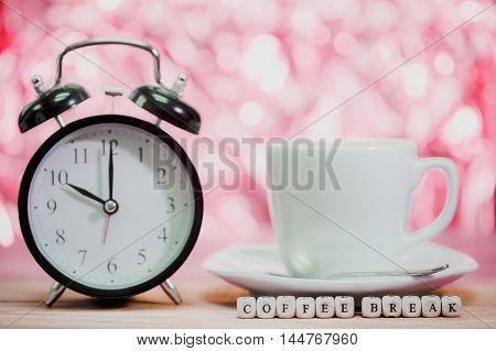 Coffee Break . coffee cup on table .Focus on COFFEE BREAK message on wood dice