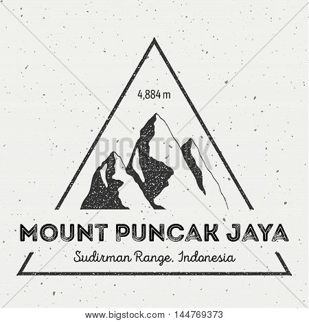 Puncak Jaya In Sudirman Range, Indonesia Outdoor Adventure Logo. Triangular Mountain Vector Insignia