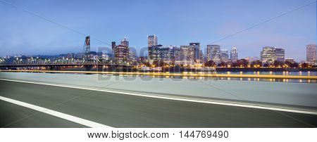 cityscape and skyline of portland from empty asphalt road
