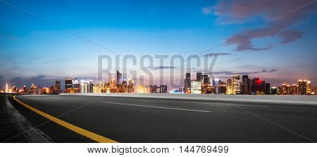 illuminated hangzhou qianjiang new city from empty road