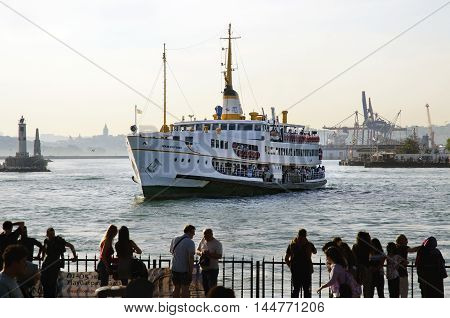 Istanbul Turkey - May 29 2016: Strait of Istanbul Kadikoy Pier Ferries are the most popular form of public transport in Istanbul for one simple reason - if you're a local you're always in a hurry except when you're on a ferry travelling from one side of t