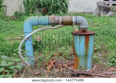 water valve plumbing steel  industrial tap pipe joints and Rusty on grass