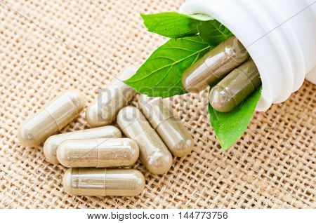 Capsules of herbs on bottle. healthy eating for healthy living.
