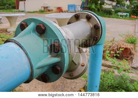 water valve plumbing steel pipe  joints and Rusty on grass