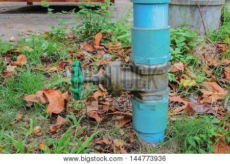 water valve plumbing steel on grass industrial tap pipe