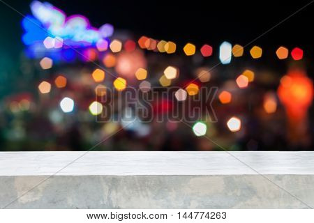 Concrete table top with abstract blurred lights, stock photo