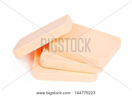 Face sponge powder isolated on white background.