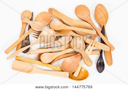 Heap of different kitchen wooden utensils cutlery on white background.