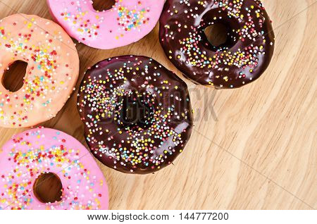 The sweet many Donuts on wooden background