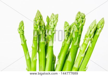 The Fresh green asparagus on white background.