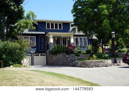 PETOSKEY, MICHIGAN / UNITED STATES - AUGUST 5, 2016: An elegant blue home near downtown Petoskey, Michigan.