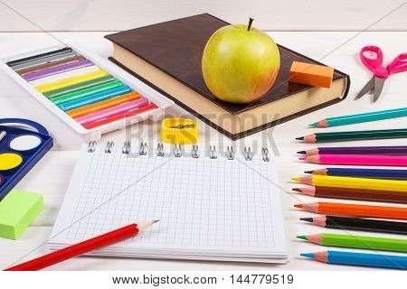 Book And School Accessories On White Boards, Back To School Concept