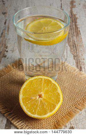 Fresh Lemon And Glass Of Clean Water With Slice Of Lemon, Cold Lemonade