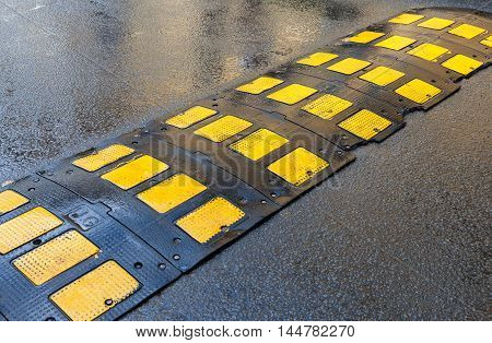 SAINT PETERSBURG RUSSIA - JULY 31 2016: Traffic safety speed bump on an asphalt road