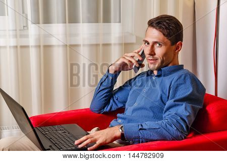 Man works for laptop. Businessman discussing on a cell phone call details of important transactions. Freelancer at work. Life is good.