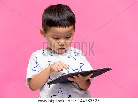 Asian little boy using dgital tablet