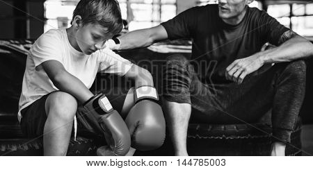 Young Boy Trainer Relaxation Lifestyle Concept