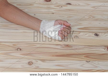Gauze bandage the hand contusion treating patients  a wrist left