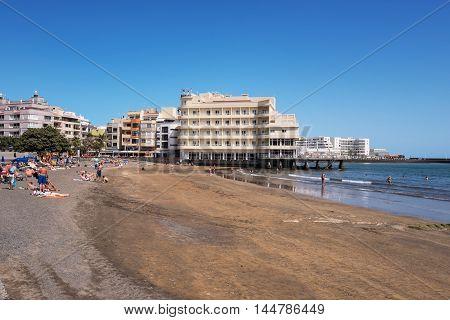 EL MEDANO SPAIN - JULY 16: Tourist relaxing at el Medano beach on july 16 2016 in El Medano Tenerife Canary islands Spain .