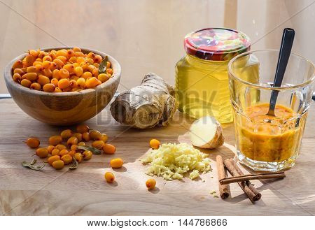 Squeezed Sea-buckthorn Berries In Glass With Ingredients For Healthy Beverage
