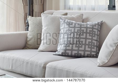 Earth Tone Sofa Set With Varies Pattern Pillows In Living Room