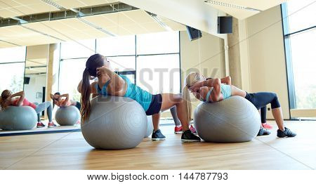 fitness, sport, exercising and lifestyle concept - group of women with exercise balls in gym