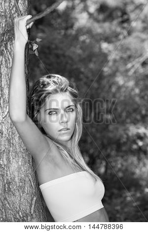 Portrait In Black And White Style Movie Star Beautiful Blonde Woman With Intense Eyes Resting On A P