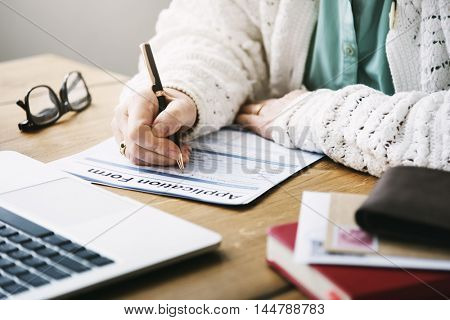 Senior Woman Filling Application Form Documents Concept