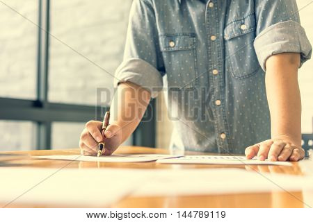 Businesswoman analyzing investment charts. Accounting soft focus vintage tone